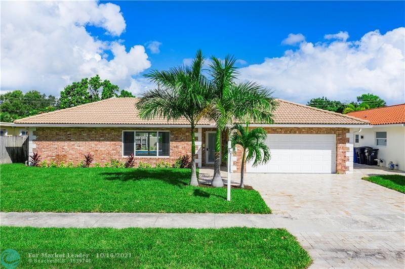 Photo of 2221 NE 56th Pl, Fort Lauderdale, FL 33308 (MLS # F10303674)