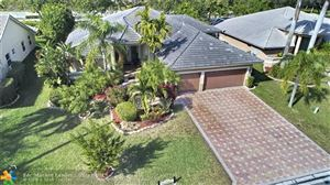 Photo of 10921 NW 55th St, Coral Springs, FL 33076 (MLS # F10158675)