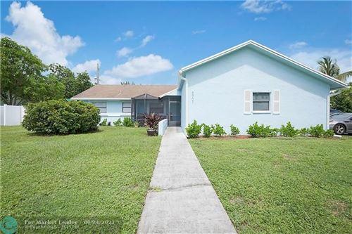 Photo of 8701 NW 48th St, Lauderhill, FL 33351 (MLS # F10301675)