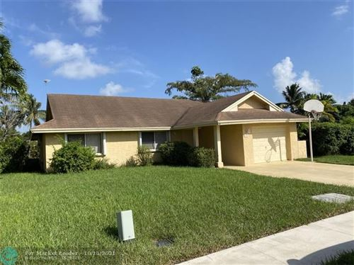 Photo of 604 SW 75th Ave, North Lauderdale, FL 33068 (MLS # F10304677)