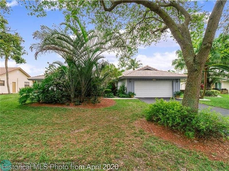 Photo of 10144 NW 2nd St, Coral Springs, FL 33071 (MLS # F10303685)
