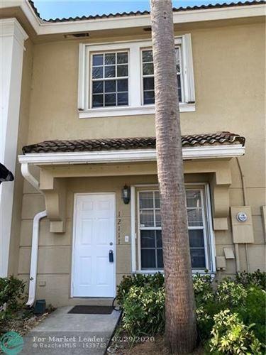Photo of 12111 SW 2nd St, Pembroke Pines, FL 33025 (MLS # F10240689)