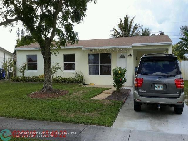 Photo of 1611 SW 68th Ter, North Lauderdale, FL 33068 (MLS # F10304696)