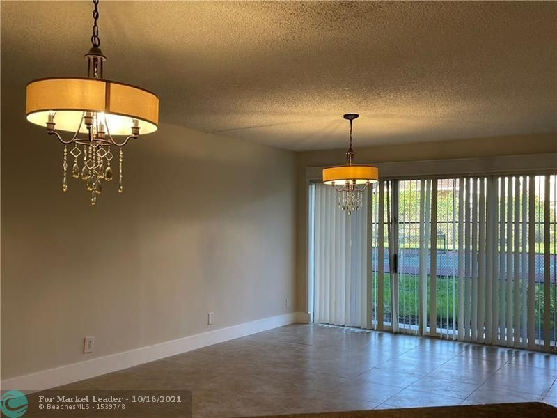Photo of 8801 Wiles Rd #108, Coral Springs, FL 33067 (MLS # F10304701)