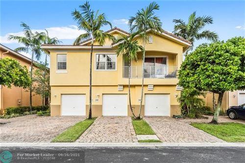 Photo of 3206 Mirella Dr, Riviera Beach, FL 33404 (MLS # F10301703)