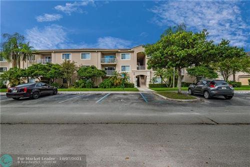 Photo of 5051 Wiles Rd #207, Coconut Creek, FL 33073 (MLS # F10303703)