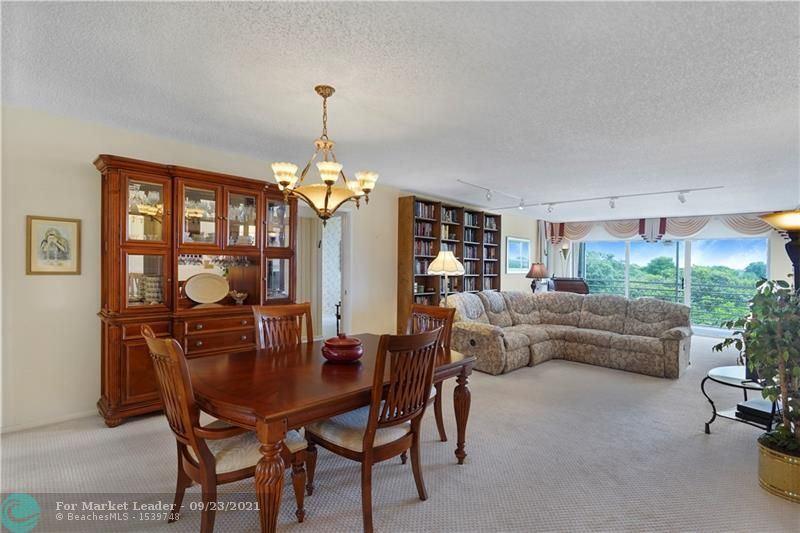 Photo of 804 Cypress Grove Ln #503, Pompano Beach, FL 33069 (MLS # F10301714)