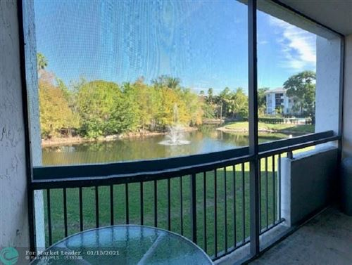 Photo of 721 N Pine Island Rd #213, Plantation, FL 33324 (MLS # F10264716)