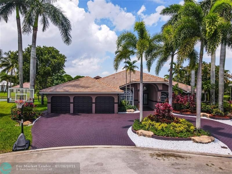 Photo of 5055 NW 102nd Dr, Coral Springs, FL 33076 (MLS # F10292716)