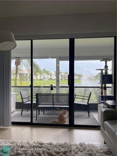 Photo of 1110 Green Pine Blvd #C1, West Palm Beach, FL 33409 (MLS # F10303718)