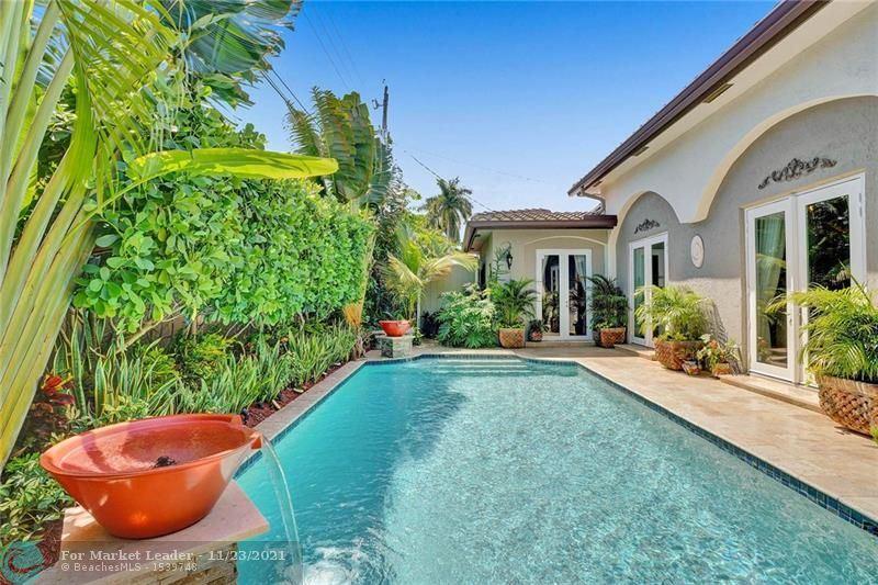 Photo of 2456 NE 27th Ave, Fort Lauderdale, FL 33305 (MLS # F10299719)
