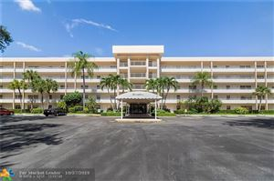 Photo of 3930 Oaks Clubhouse Dr #303, Pompano Beach, FL 33069 (MLS # F10200720)