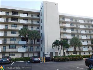 Photo of 2430 Deer Creek Country Club Blvd #107, Deerfield Beach, FL 33442 (MLS # F10137728)