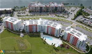 Photo of 3800 Crystal Lake Dr #506, Deerfield Beach, FL 33064 (MLS # F10200728)