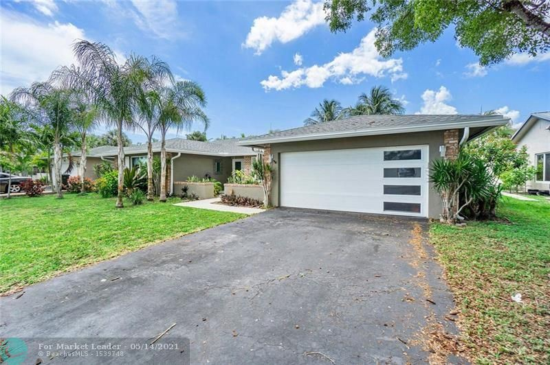 Photo of 1890 NW 40th Ct, Oakland Park, FL 33309 (MLS # F10283729)