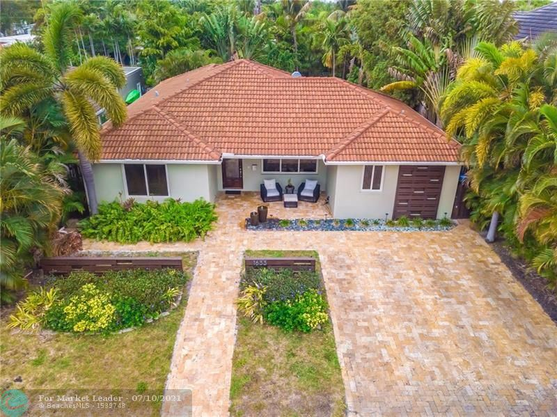 Photo of 1633 NE 18th Ave, Fort Lauderdale, FL 33305 (MLS # F10283734)