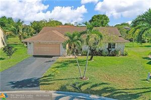 Photo of 11372 NW 43rd Pl, Coral Springs, FL 33065 (MLS # F10177736)