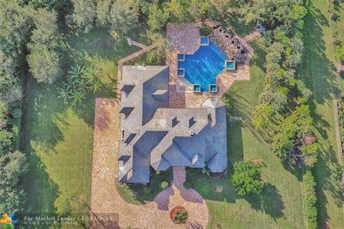 Photo of 6620 Holmberg Rd, Parkland, FL 33067 (MLS # H10585736)