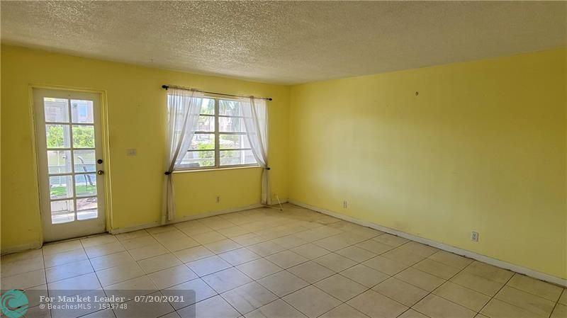 Photo of 801 NE 18th Ct #110, Fort Lauderdale, FL 33305 (MLS # F10293736)