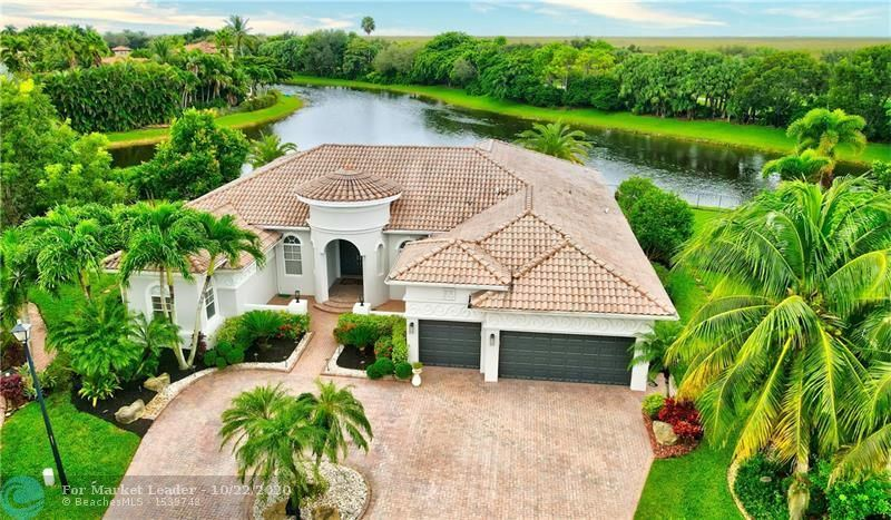 Photo of 7445 NW 127th Ter, Parkland, FL 33076 (MLS # F10254737)