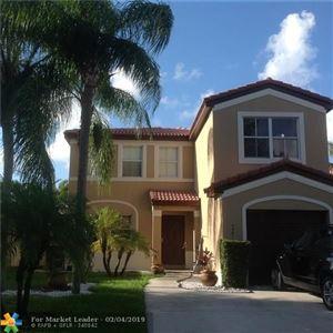 Photo of 4381 NW 1st Dr, Deerfield Beach, FL 33442 (MLS # F10160746)