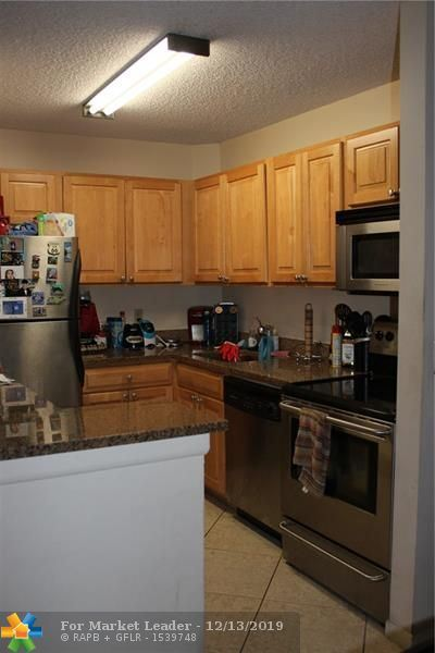 Photo of 10773 Cleary Blvd #304, Plantation, FL 33324 (MLS # F10206746)