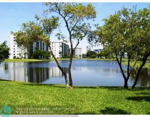 Photo of 2216 N CYPRESS BEND DR #302, Pompano Beach, FL 33069 (MLS # F10284746)