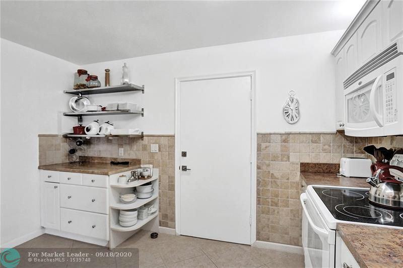 Photo of 4851 NW 21st St #409, Lauderhill, FL 33313 (MLS # F10249747)