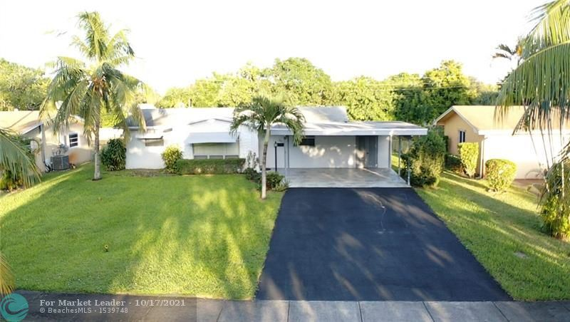 Photo of 240 NW 43rd Ave, Plantation, FL 33317 (MLS # F10304754)