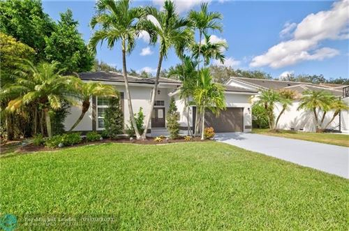 Photo of 5989 NW 74th St, Parkland, FL 33067 (MLS # F10302755)