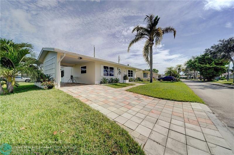 Photo of 2311 NW 54th St, Tamarac, FL 33309 (MLS # F10301764)