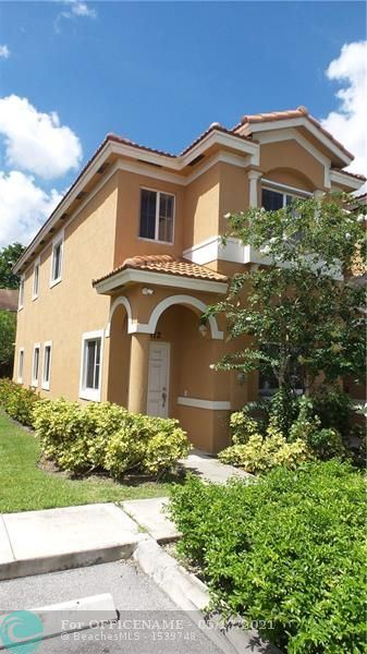 Photo of 5912 Woodlands Blvd, Tamarac, FL 33319 (MLS # F10284770)