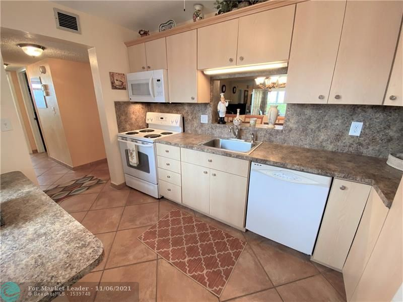 Photo of 4270 NW 40th St #415, Lauderdale Lakes, FL 33319 (MLS # F10305770)