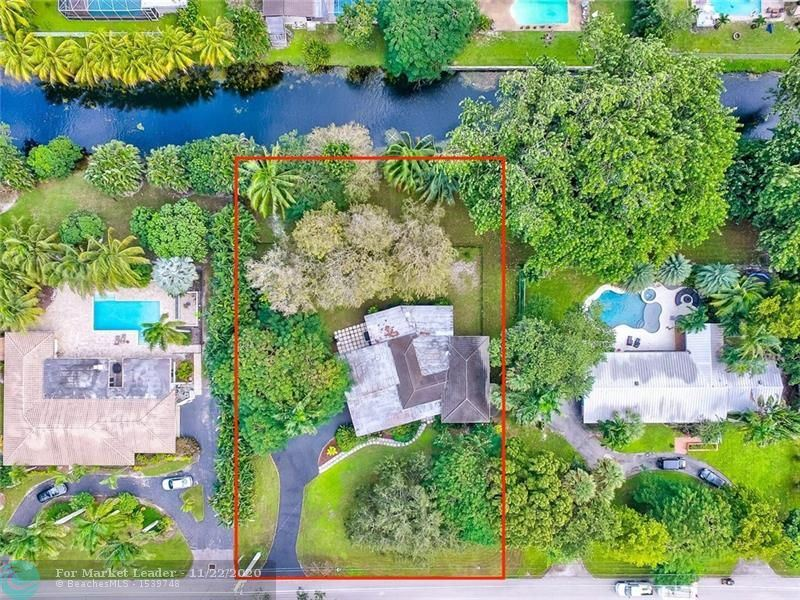Photo of 320 E Tropical Way, Plantation, FL 33317 (MLS # F10259776)