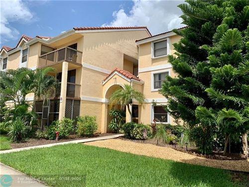 Photo of 5801 Riverside Dr #104, Coral Springs, FL 33067 (MLS # F10293783)