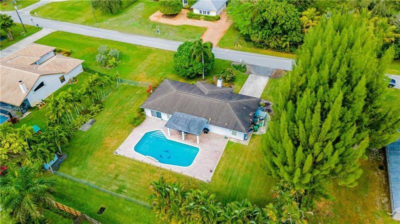 Photo of 11580 SW 3rd St, Plantation, FL 33325 (MLS # F10270788)