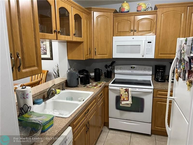 Photo of 4149 NW 90th Ave #202, Coral Springs, FL 33065 (MLS # F10278788)