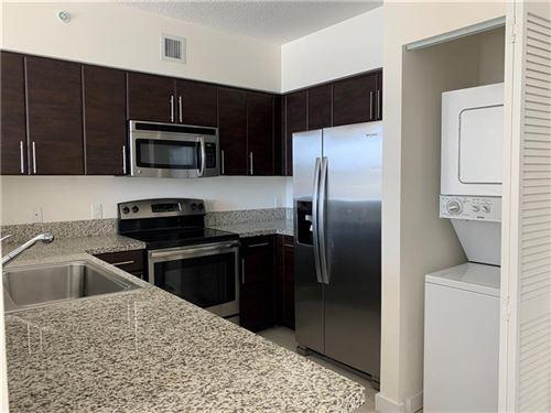 Photo of 987 SW 37 Ave #1214, Miami, FL 33135 (MLS # F10272789)