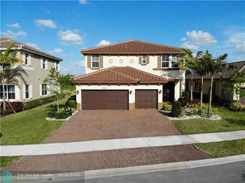 Photo of 8640 Miralago Way, Parkland, FL 33076 (MLS # F10230791)