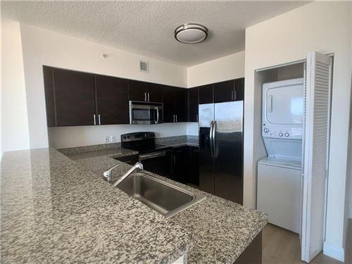 Photo of 987 SW 37 Ave #1105, Miami, FL 33135 (MLS # F10272791)