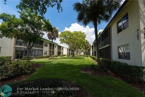 Photo of 4127 NW 88th Ave #204, Coral Springs, FL 33065 (MLS # F10241792)