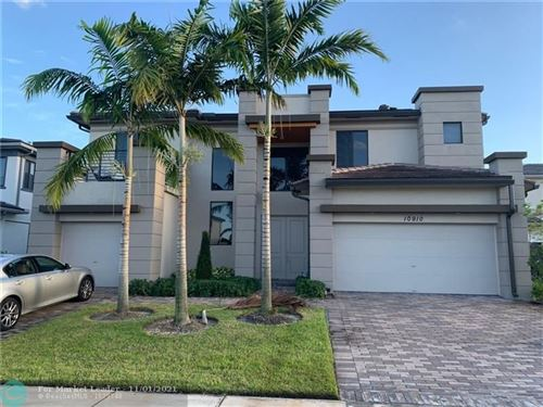 Photo of 10910 N Shore St, Parkland, FL 33076 (MLS # F10302792)