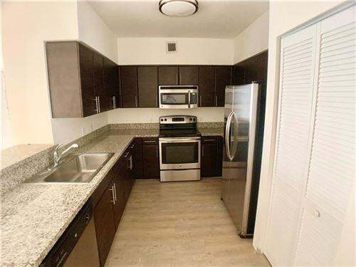 Photo of 987 SW 37 Ave #810, Miami, FL 33135 (MLS # F10272793)