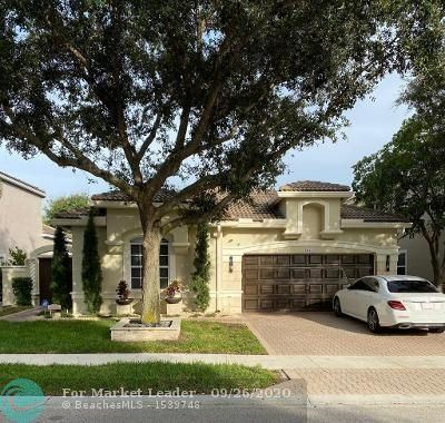 Photo of 5841 NW 125th Ave, Coral Springs, FL 33076 (MLS # F10250803)