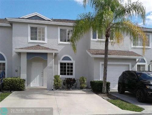 Photo of 1460 SW 47th Ave, Deerfield Beach, FL 33442 (MLS # F10219807)