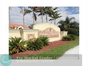 Photo of 1225 SW 46th Ave #205, Pompano Beach, FL 33069 (MLS # F10250808)