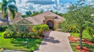 Photo of 11222 NW 68th Pl, Parkland, FL 33076 (MLS # F10188813)