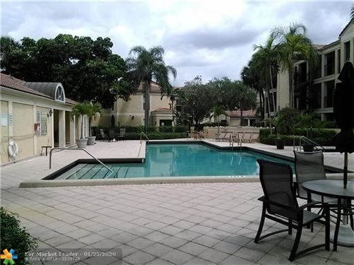 Photo of 875 NW Riverside Dr #721, Coral Springs, FL 33071 (MLS # F10212814)