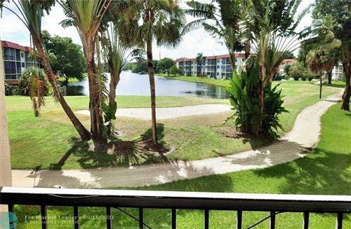 Photo of 411 S Hollybrook Dr #206, Pembroke Pines, FL 33025 (MLS # F10299821)