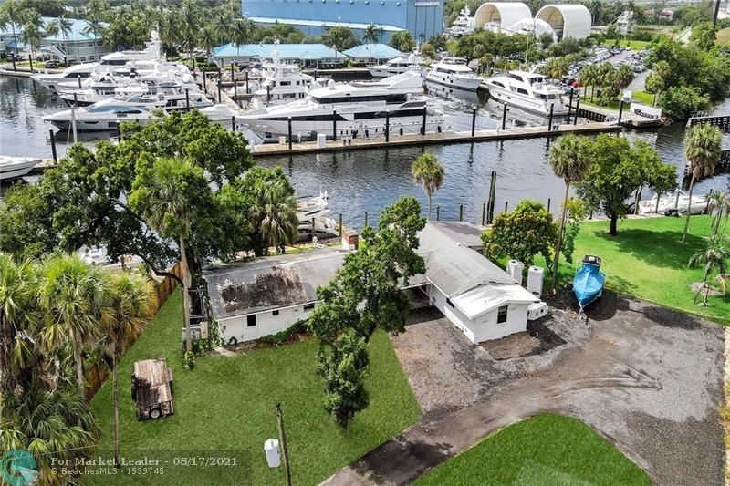 Photo of 2090 SW 16th Ct, Fort Lauderdale, FL 33312 (MLS # F10292821)